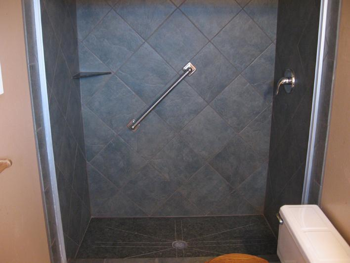 INSTALLATION OF ONE PIECE GRANITE SHOWER PAN PIC