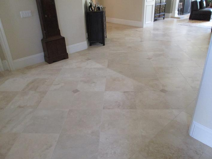 PHOTO IMAGE OF BEFORE CLEANING & RESEALING TRAVERTINE TILE FLOOR.