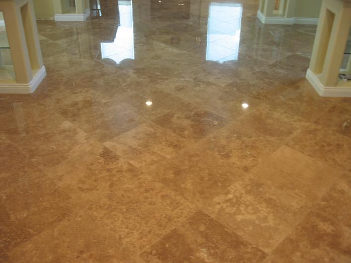 Installation of 18 inch Polished Travertine Tile Flooring on a diagonal layout in San Diego. Professional tile installation contractor working in SAn Diego areas Poway Carlsbad Escondido Alpine Chula Vista La Jolla Coronado Del Mar Solana Beach Rancho Bernardo Rancho Santa Fe areas